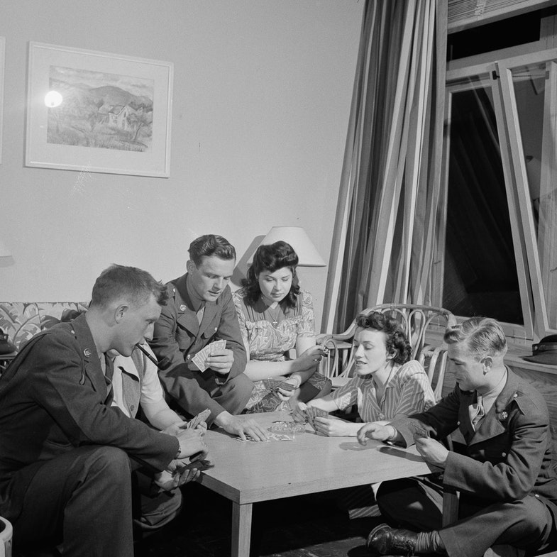 Arlington, Virginia. Girls entertaining their guests in one of the two card rooms, at a residence for the women who work in the U.S. government for the duration of the war. More privacy is afforded here than in the main lounge
