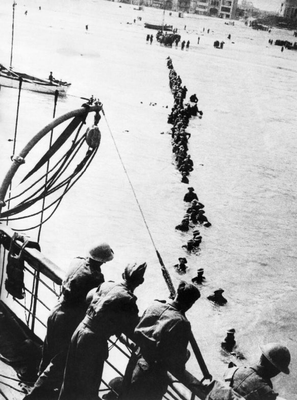 British soldiers wade out to a waiting destroyer off Dunkirk during Operation Dynamo