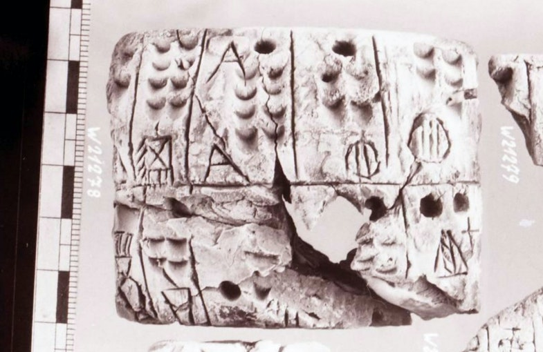 . Economic tablet dealing with quantities of textiles, from Uruk, Iraq, ca. 3100 BC