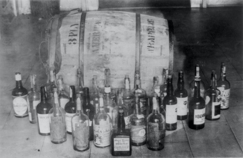 Bottles and barrel of confiscated whiskey 1920