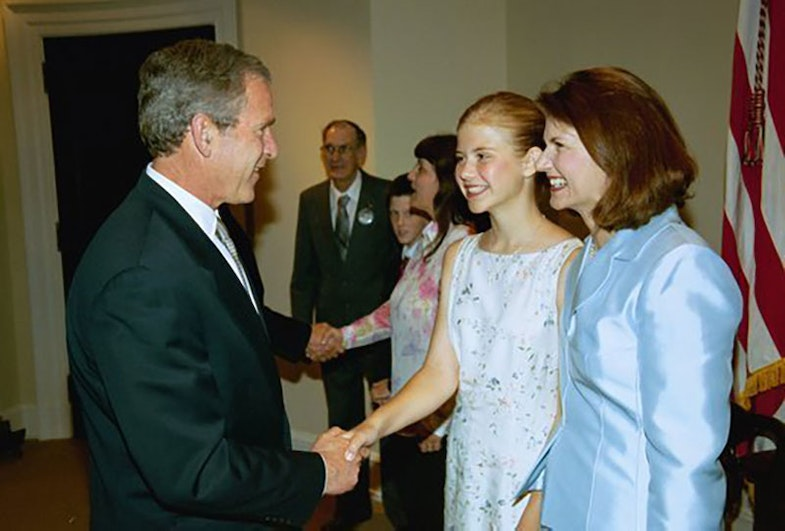 President George W. Bush greets Elizabeth Smart, center, and her mother Lois Smart in the Roosevelt Room Wednesday, April 30, 2003