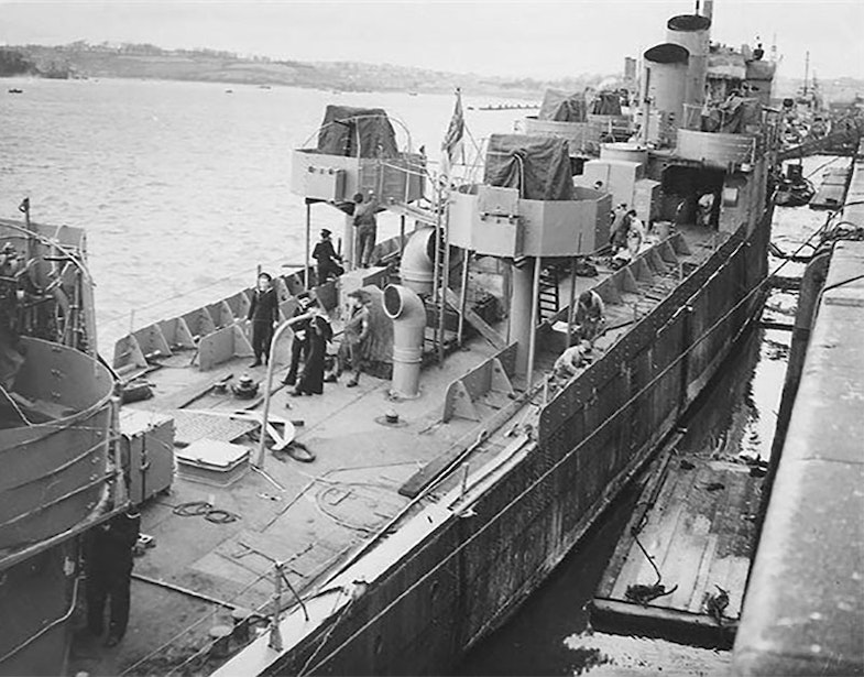 HMS Campbeltown being converted for the raid. There are twin lines of armour plate down each side of the ship and the Oerlikon mountings. Two of her funnels have been removed, with the remaining two cut at an angle St Nazaire Raid