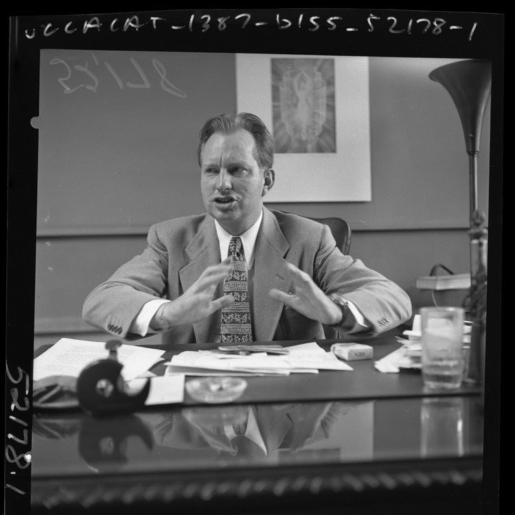 L. Ron Hubbard seated as desk, 1950