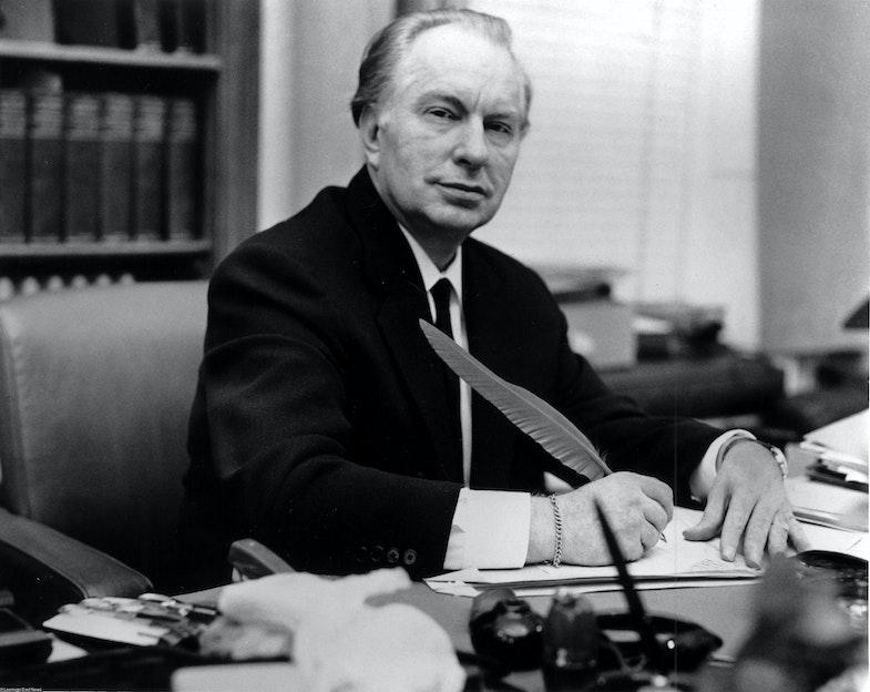 Ron Hubbard at his desk