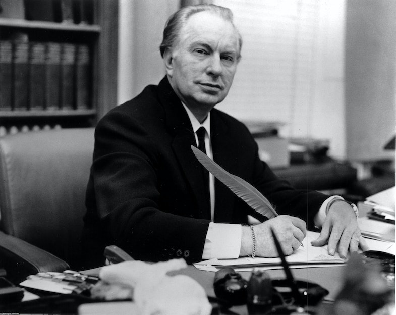 Ron Hubbard at his desk