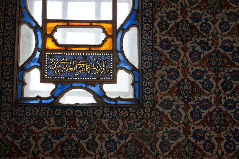 Iznik tile work and stained glass window in the Harem of Topkapi Palace