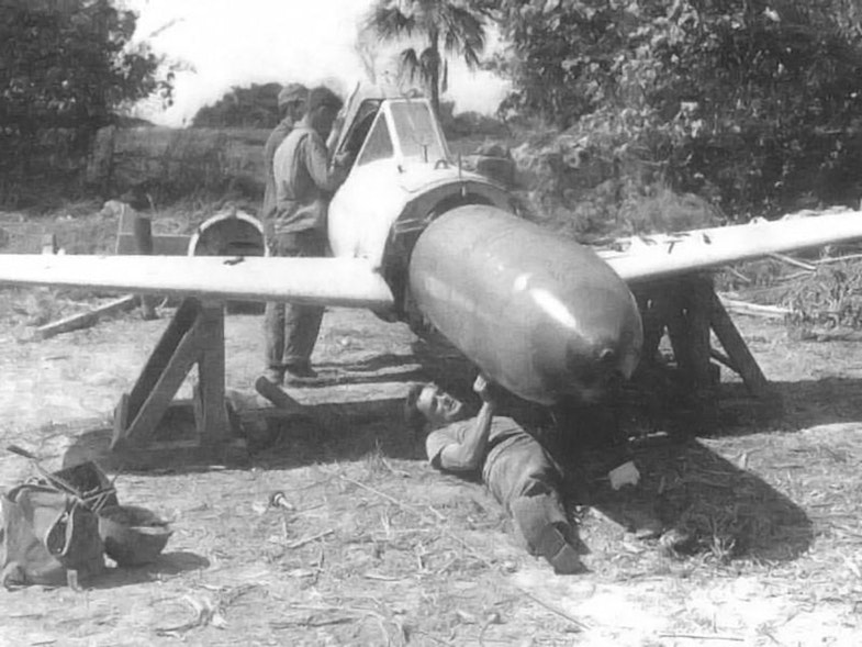 US Personnel conduct a warhead disassembly on a captured Yokosuka MXY7 Ohka in 1945