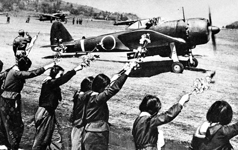Chiran high school girls are waving farewell with cherry blossom branches to a taking-off kamikaze pilot. The pilot is Second Lieutenant Toshio Anazawa of Army Special Attack Unit (20th Shinbu party). The aircraft, an Army Type 1 fighter