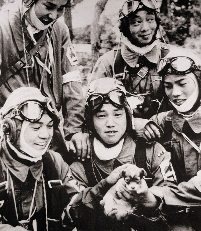 Corporal Yukio Araki (centre) holds a puppy in a group photo taken one day before his death, 26 May 1945.