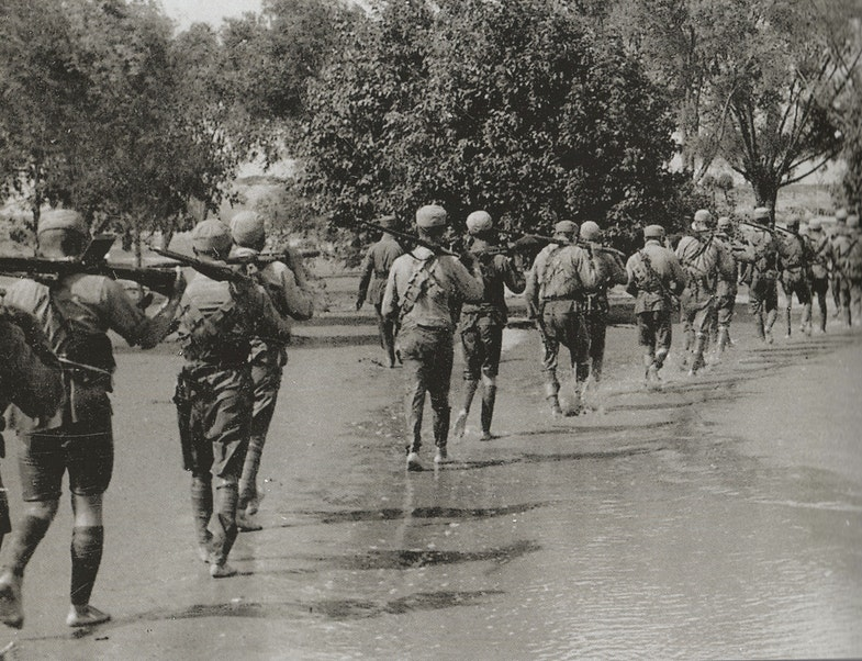 Chinese Nationalist troops walking through Yellow River floodwaters