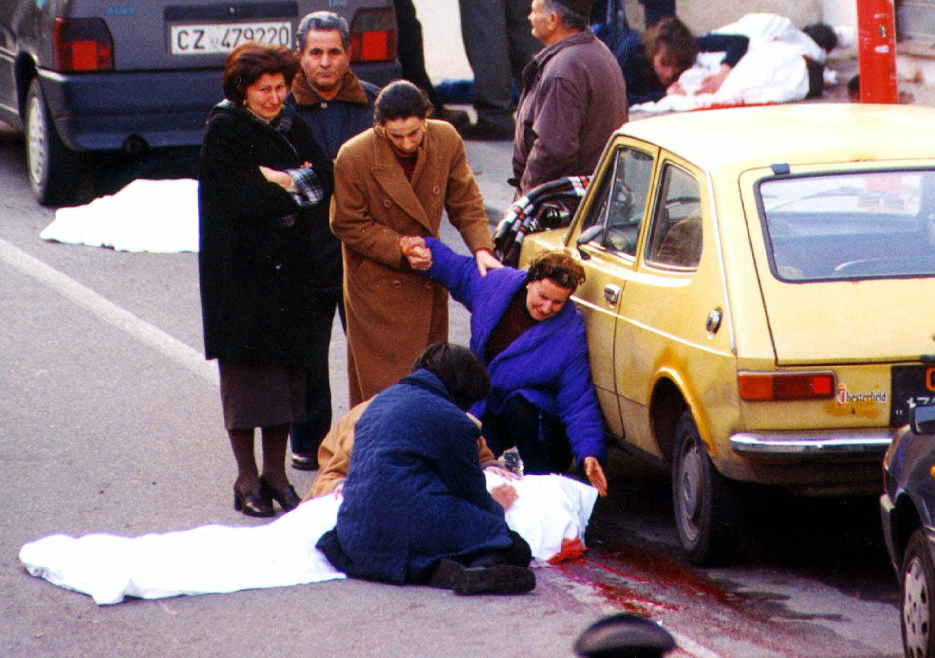 Relatives of the alleged 'Ndrangheta (Calabrian mafia) boss Salvatore Valente, 39, cry after Valente, together with two other suspected mobsters and a man caught in the crossfire, were killed in a shootout Saturday, Feb. 26, 2000 in Strongoli, Cotrone, Italy in this southern Italian town's main street