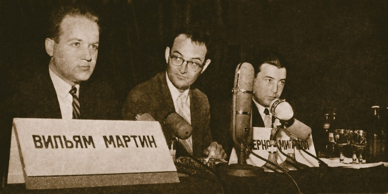 (Left) William Martin and Bernon Mitchell (Center) tell Moscow press why they defected