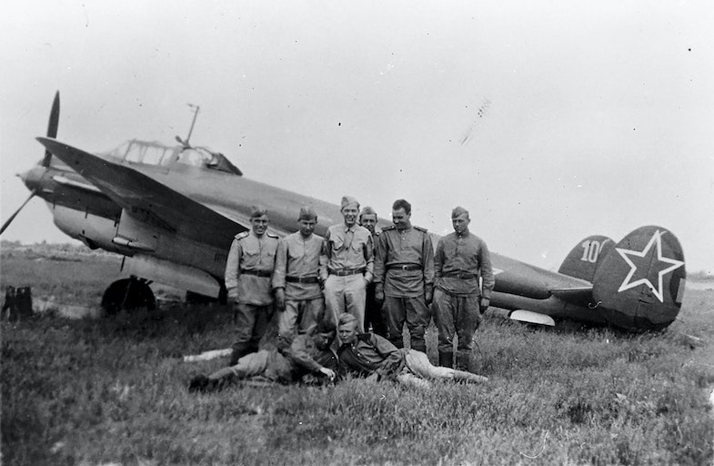Russian pilots and ground crew stand in front of a Petlyakov Pe-2 light bomber at Poltava, Russia, during the first shuttle raid -- Italy to Russia and return -- in June 1944. GI is TSgt. Bernard J. McGuire, Tonawanda, N.Y., of the 348th Bomb Squadron, 99th Bomb Group
