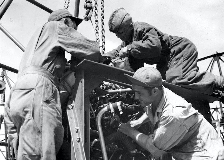 MSgt. John M. Bassett, Lenin Boykov of Leningrad, and MSgt. Michael Cajolda service a visiting task force bomber