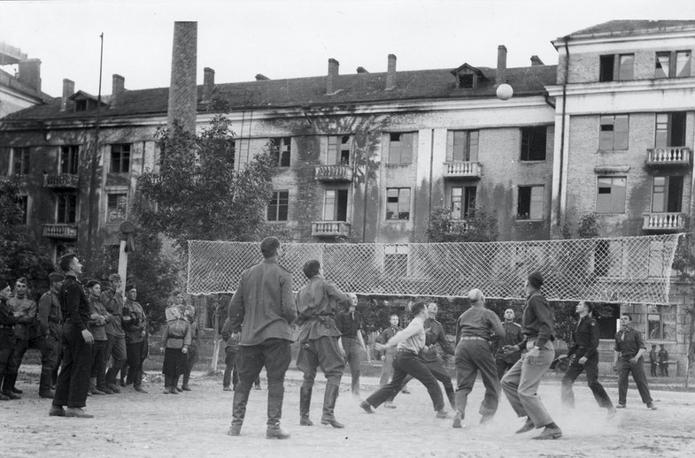 The Soviets turned out to be expert volleyball players, and every night in the courtyard of Eastern Command HQ at Poltava, there were fast mixed games. Player fifth from the right at bottom is Gen. Ira Eaker
