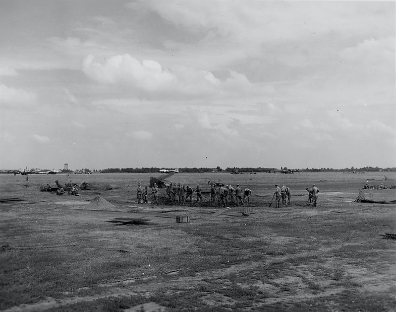 Soviet soldiers are repairing the airfield of the 169th airbase of special purpose near Poltava after german bombing