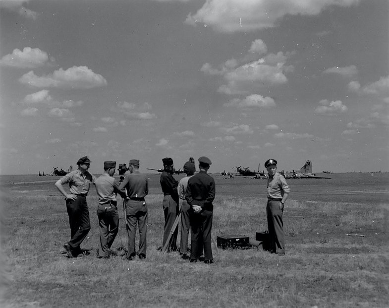 American officers at the airfield near Poltava consider the consequences of the German bombardment on the night of July 22, 1944
