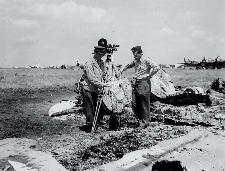 American cameramen among the wreckage of the aircraft. The Consequence of the German Bombing on the Night of July 22, 1944