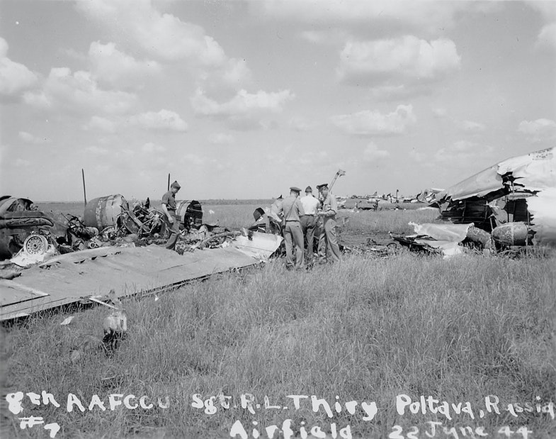 American officers among the wreckage of the B-17 bomber