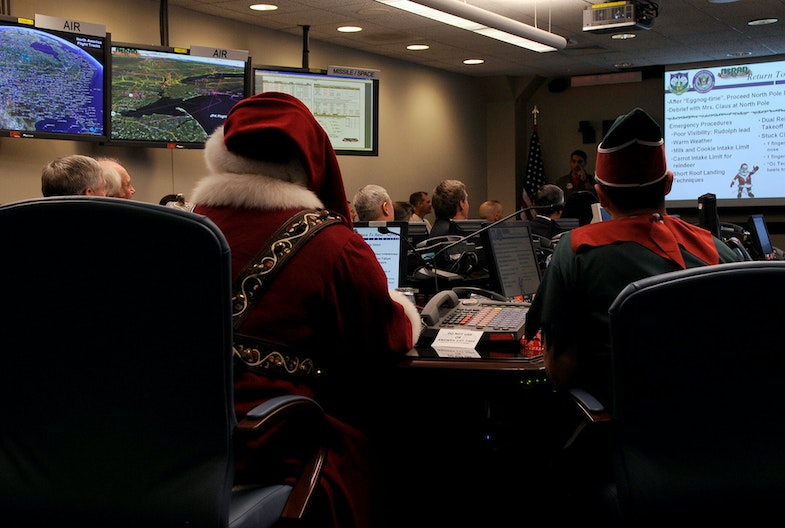 Santa Claus makes a surprise visit to the North American Aerospace Defense Command Tracks Santa Battle Cab