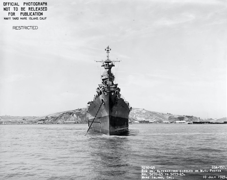 9-N-86913, bow view of Indianapolis after final overhaul, Mare Island, 10 July 1945. This series of photographs was taken days before Indianapolis steamed for Tinian to deliver components for the A-Bomb
