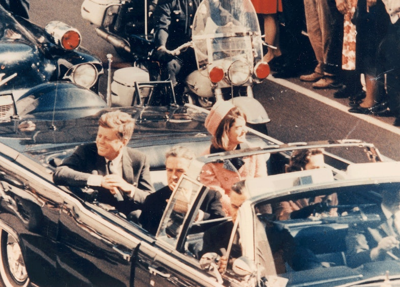 Picture of President Kennedy in the limousine in Dallas, Texas, on Main Street, minutes before the assassination