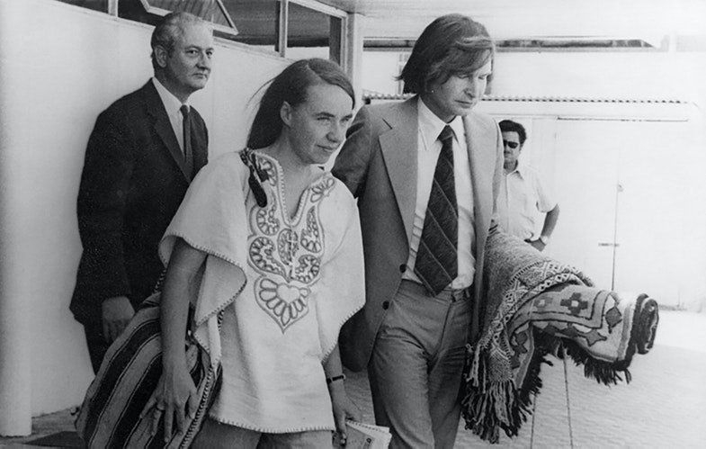 Kozak escorts British doctor Sheila Cassidy to the plane taking her out of Chile, in 1975
