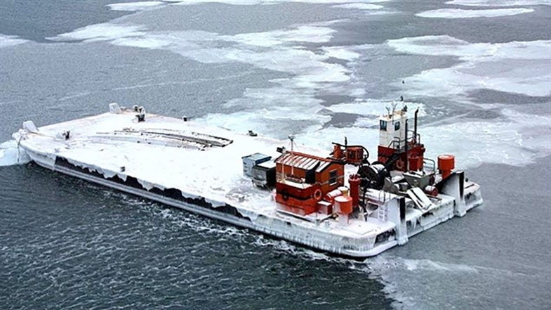 Clad in ice the NTCL barge has been pushed erratically some 800 kilometer across Arctic seas by the wind