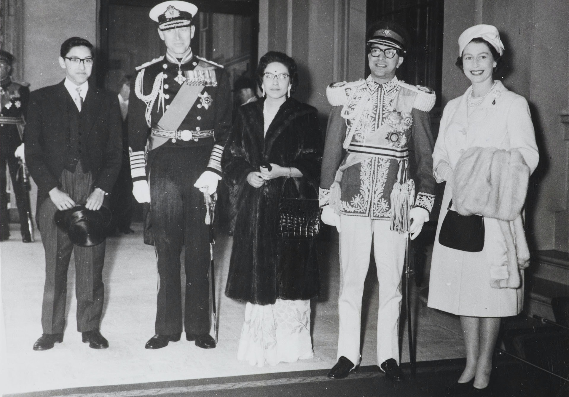 Group photograph with (l-r): The Duke of Edinburgh wearing Admiral of the Fleet uniform, Queen Ratna of Nepal, King Mahendra of Nepal and Queen Elizabeth of Great Britain. Picture taken on their arrival at Buckingham Palace.