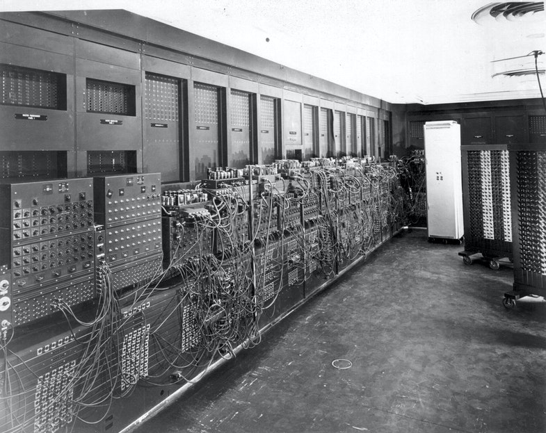 Photo of left side of ENIAC as installed in BRL Bldg 328. The white cabinet in the rear is the core memory, a late addition