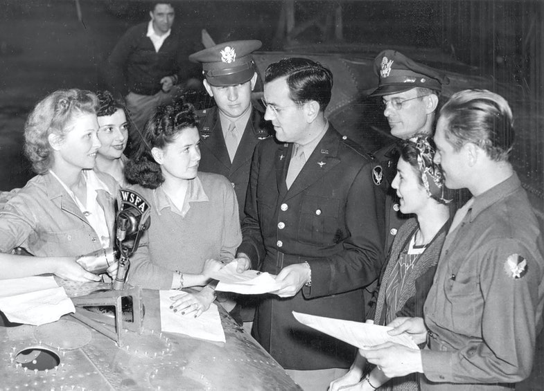 Glenn Miller, center, prepares for one of the more than 500 radio broadcasts in which he and his band performed as part of morale-boosting efforts in the Army Air Force