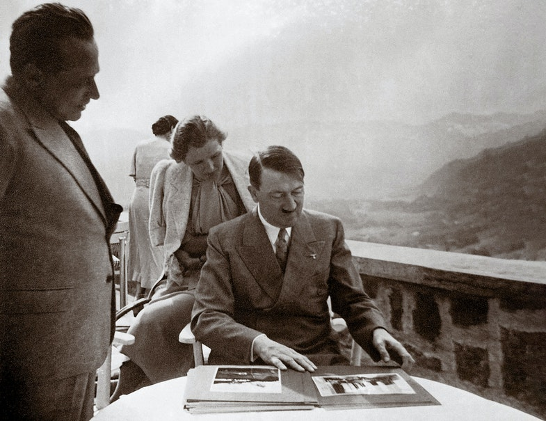 Eva Anna Paula Braun (1912 - 1945) and Adolf Hitler (1889 - 1945) at Berghof. Hitler and Eva Braun are looking at photos Hoffmann has brought along. Heinrich Hoffmann was the official photographer for the Nazi Party (NSDAP) and Eva Braun had worked for his agency, where she met Hitler in 1929