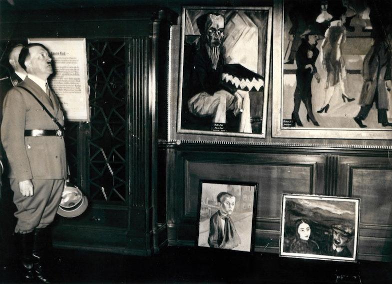 Hitler visiting the degenerate art exhibition in munich, 1937