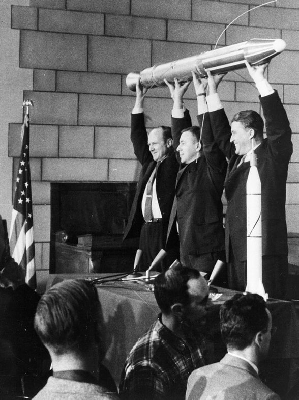 The creators of Explorer 1 holding a model of it on the press conference at launch day (or the day before), February 1, 1958 (or January 31, 1958). Starting from left side: Ph.D. William Pickering, Ph.D. James Van Allen, Ph.D. Wernher von Braun