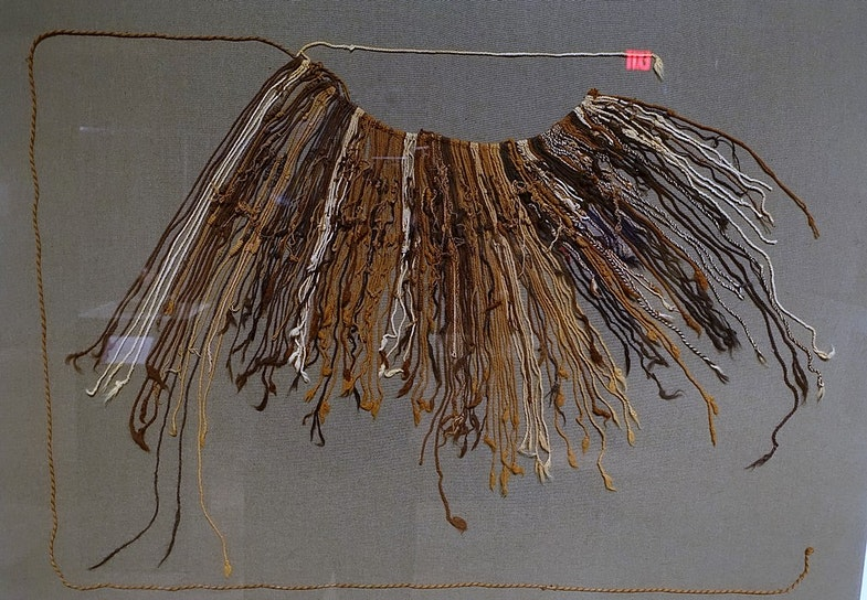 Fragmentary quipu (khipu) composed of two main cords with subsidiary and tertiary cords