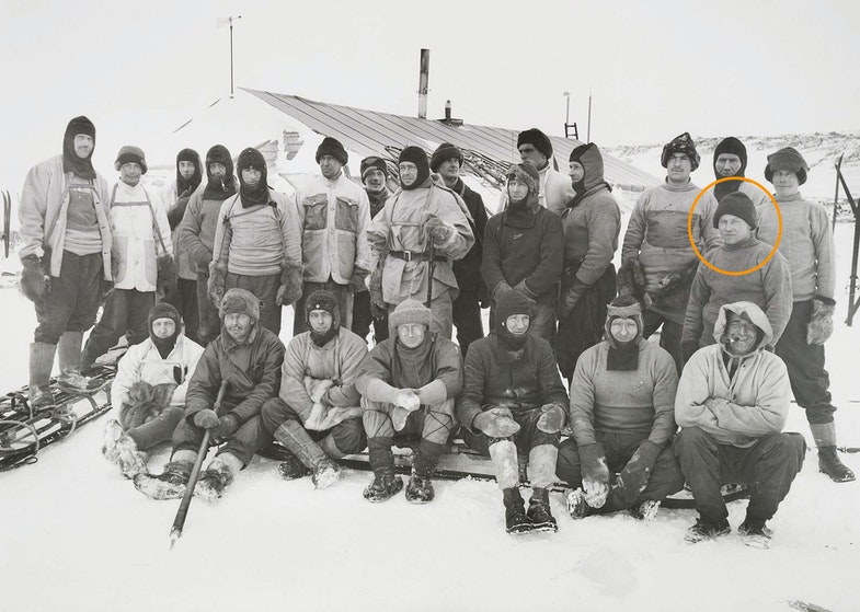 This group is the Shore Party - the men who remained in Antarctica throughout the winter of 1911, preparing for Scott's final departure for the Pole. They pose in front of the expedition hut at Cape Evans. The only people not visible are Clissold, the cook, and Ponting, the photographer. Scott is at the centre of the group and all the men look relaxed.
