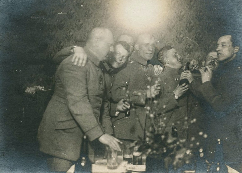 Junger (right with cigar) drinking with fellow officers of the 73rd behind the lines, 1917
