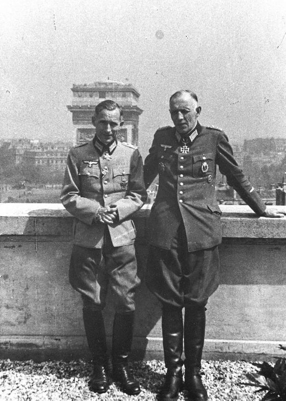 ünger, standing with fellow Wehrmacht officer, Colonel Eberhard Wildermuth, on the roof of their Paris hotel, 1942