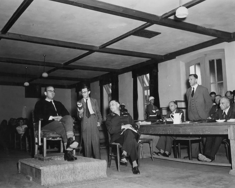 Dr. Morgan; German radio reporter, Werner Klein; interpreter, Rudolph Nathanson, WDC; and defense attorney, Dr. Wacker. Dr. Morgan was an investigator who came to Buchenwald to investigate Commander Koch, who was in charge at the time. Through Dr. Morgan's investigation Koch was arrested and executed. Dr. Morgan is also a prisoner at Dachau