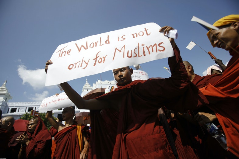 A Myanmar Buddhist monk holds a sign as he takes part in a demonstration against the Organisation of the Islamic Conference in Yangon on October 15, 2012. Thousands of monks took to the streets in Myanmar's two main cities on October 15 to protest against a world Islamic body's attempts to help Muslim Rohingya in unrest-hit Rakhine state, organisers said