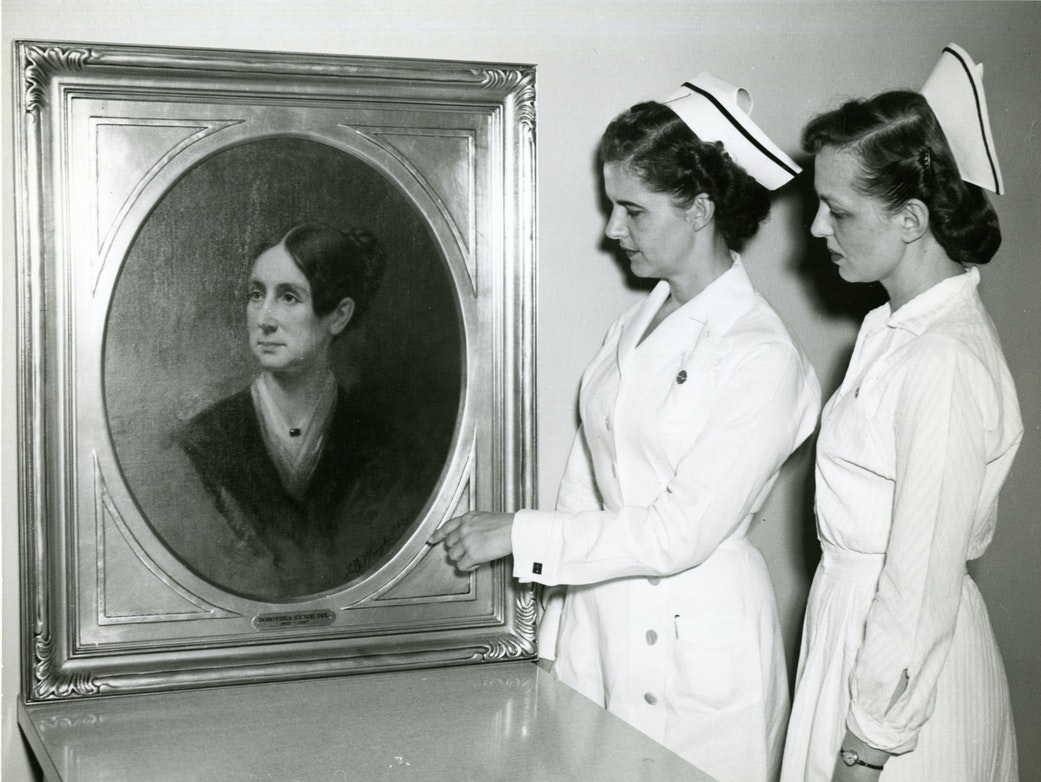 St. Elizabeths nurses in the 1950s study a portrait of Dorothea Lynde Dix, a 19th century social reformer. Dix helped found the treatment facility in the 1850s