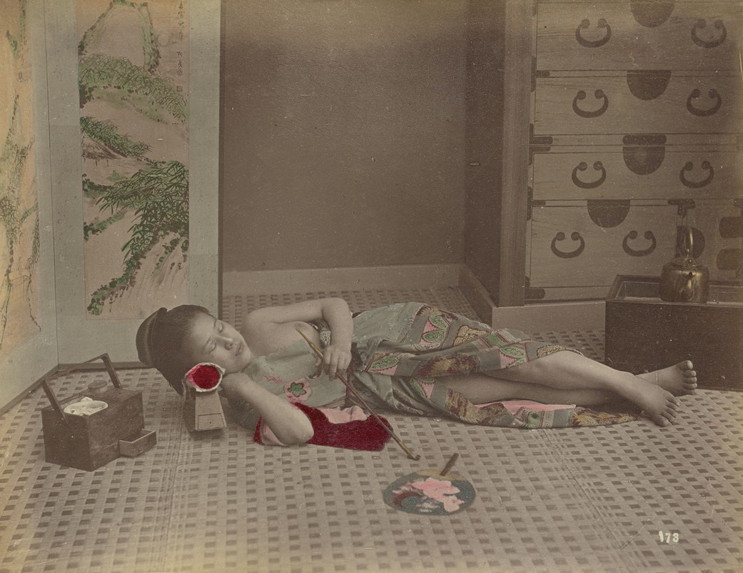 [Woman Reclining with Pipe]; Kusakabe Kimbei (Japanese, 1841 - 1934, active 1880s - about 1912); Japan; 1870s - 1890s; Hand-colored albumen silver print; 20.3 x 26.3 cm (8 x 10 3/8 in.); 84.XA.700.4.7